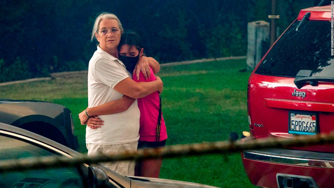 Family members comfort each other as the El Dorado Fire moves closer to their home in Yucaipa, California, on September 6.