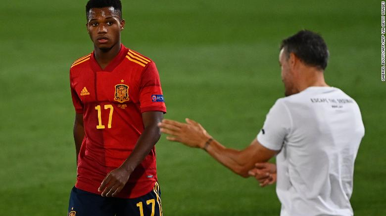 Coach Luis Enrique gives instructions to Ansu Fati during the UEFA Nations League match.