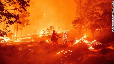California wildfires rage as rescues and evacuations continue