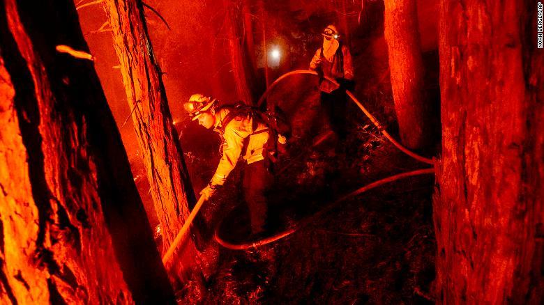 Firefighter Nick Grinstead battles the Creek Fire in Shaver Lake, California, on September 7.