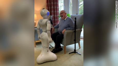 Pepper engages in conversation with a care home resident.