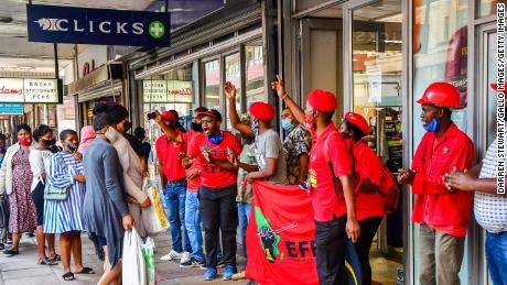 EFF Members stop public from entering a Clicks store in the CBD during the national shutdown of all Clicks outlets on September 07, 2020 in Durban, South Africa.