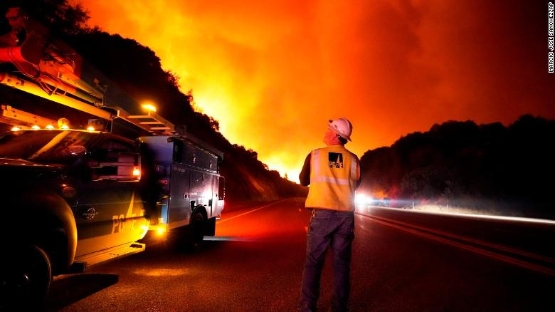 A Pacific Gas and Electric worker looks up at the advancing Creek Fire near Alder Springs, California, on Tuesday, September 8.