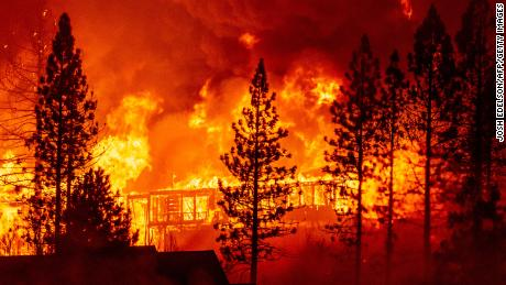 "A home is engulfed in flames during the ""Creek Fire"" in the Tollhouse area of unincorporated Fresno County, California early on September 8, 2020."