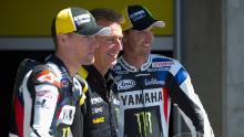 Poncharal poses with Ben Spies (left) and Colin Edwards (right).