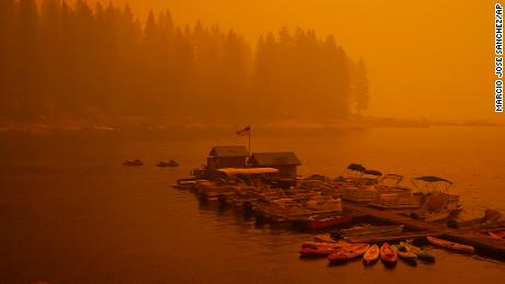 Smoke from the Creek Fire fills the air over a boating dock, Sunday, Sept. 6, 2020, in Shaver Lake, Calif.