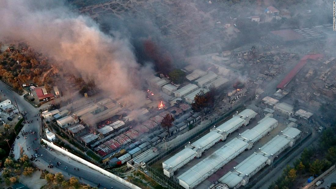 This aerial photo shows burning container houses and tents.