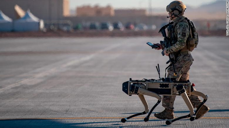 US Air Force Tech. Sgt. John Rodiguez patrols with a Ghost Robotics Vision 60 prototype during the Advanced Battle Management System exercise on Nellis Air Force Base, Nevada, on September 3, 2020.
