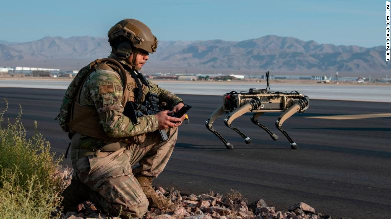 A Ghost Robotics Vision 60 unit operates with a US Air Force sergeant during an exercises at Nellis Air Force Base in Nevada.