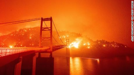 Fire surrounds the Bidwell Bar Bridge in the Oroville area on Wednesday.