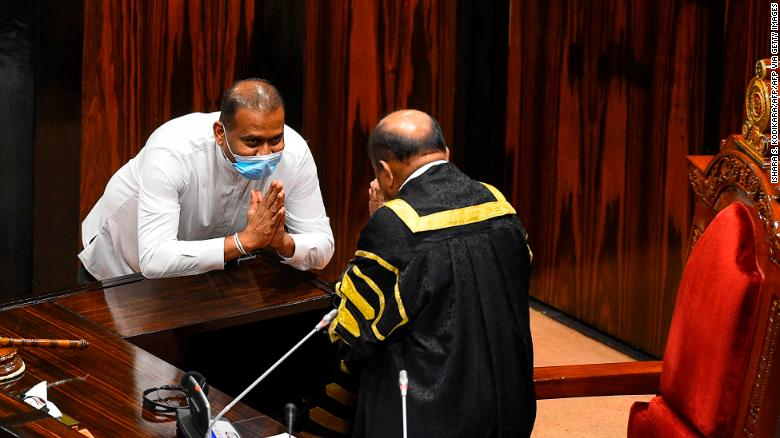Convicted murderer Premalal Jayasekara bows after he is sworn in as a member of Sri Lanka's parliament in Colombo on September 8, 2020.