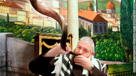 Rabbi Moshe Wilansky, of Chabad of Maine, blows the shofar before the start of a Rosh Hashanah service.