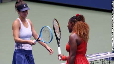 Serena Williams, right, and Tsvetana Pironkova exchange a smile after their US Open quarterfinal ended.
