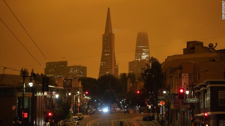 Looking up Columbus Avenue, the Transamerica Pyramid and Salesforce Tower are covered with smoke from wildfires late Wednesday morning on Wednesday, September 9, in San Francisco.