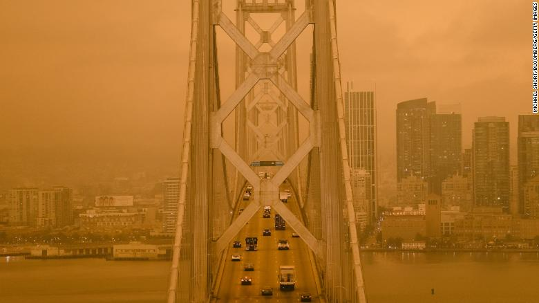 Smoke from California wildfires hangs over the San Francisco - Oakland Bay Bridge on Wednesday.
