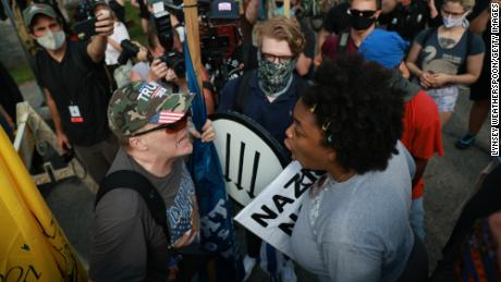STONE MOUNTAIN, GA - AUGUST 15: A woman argues with a far-right protester during a rally on August 15, 2020 near the downtown of Stone Mountain, Georgia. Georgia's Stone Mountain Park which is famous for its large rock carving of Confederate leaders planned to close on Saturday in response to a planned right-wing rally. (Photo by Lynsey Weatherspoon/Getty Images)