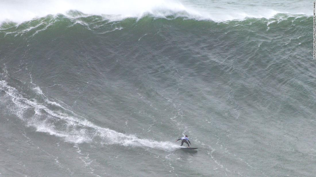 A Brazilian surfer broke her own Guinness World Records title by riding an epic wave
