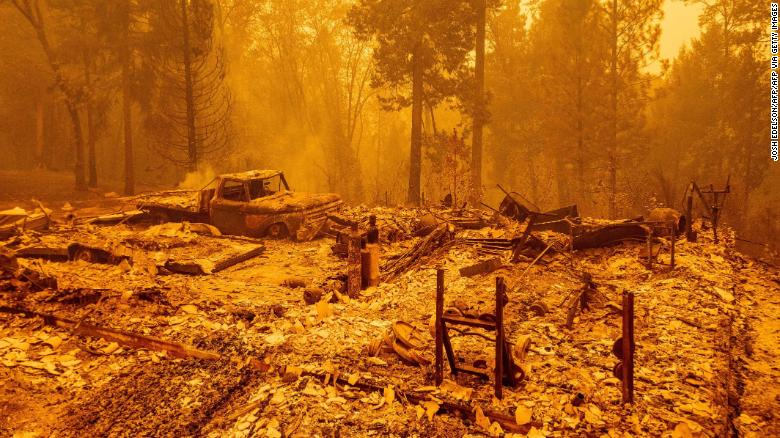 A burned residence smolders during the Bear fire, part of the North Lightning Complex fires, in unincorporated Butte County, California on September 9, 2020.
