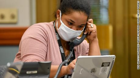 Census worker Anna Arroyo takes calls about the census at City Hall in Reading, Pennsylvania, on September 1.