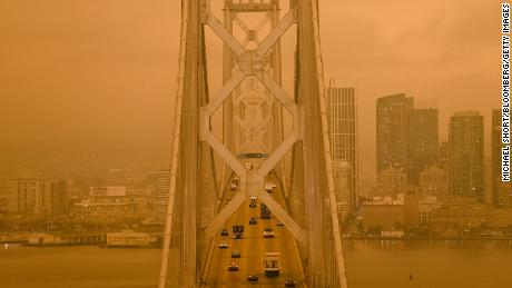 Smoke from California wildfires hangs over the San Francisco - Oakland Bay Bridge in San Francisco, California, U.S., on Wednesday, Sept. 9, 2020.