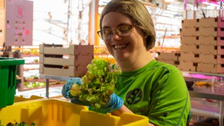 Mycah Miller, a Vertical Harvest employee, packages lettuce greens to be delivered to one of four grocery stores the vertical farm services in Jackson, Wyoming.