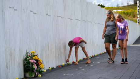 Madison, left, Lisa, center, and Natalie Grudowski of North Versailles, Pa., visit the Wall of Names at the Flight 93 National Memorial in Shanksville.