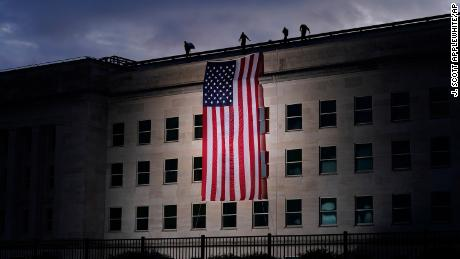 A large American flag is unfurled at the Pentagon ahead of ceremonies at the National 9/11 Pentagon Memorial honoring the 184 people killed there.