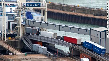 Lorries begin to board a ferry at the UK port of Dover.