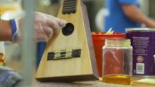 "A triangle ukulele crafted by students at ""Culture of Recovery."""