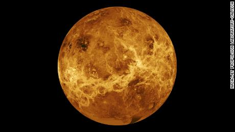A global view of the surface of Venus centered at 180 degrees east longitude. The simulated hues are based on color images recorded by the Soviet Venera 13 and 14 spacecraft.