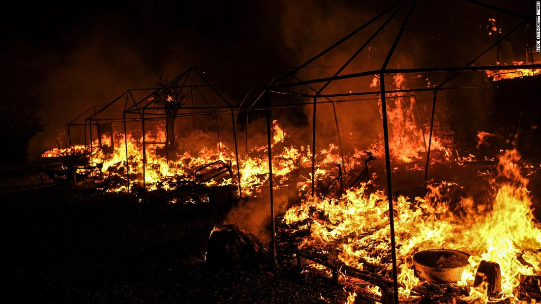 Fires rage in the Moria camp on September 9. Greek authorities said the fires appeared to have been deliberately lit after quarantine rules were imposed on residents who had tested positive for coronavirus. The camp was put under lockdown after 35 people tested positive for Covid-19.