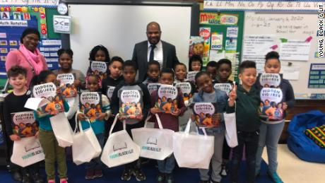 An elementary class in Evanston, Illinois, receives free books from the nonprofit Young, Black & Lit, whose mission is to give away books with Black main characters.