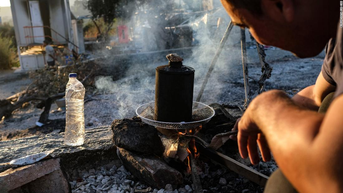 An Afghan migrant starts a fire for his family's morning tea on September 11.