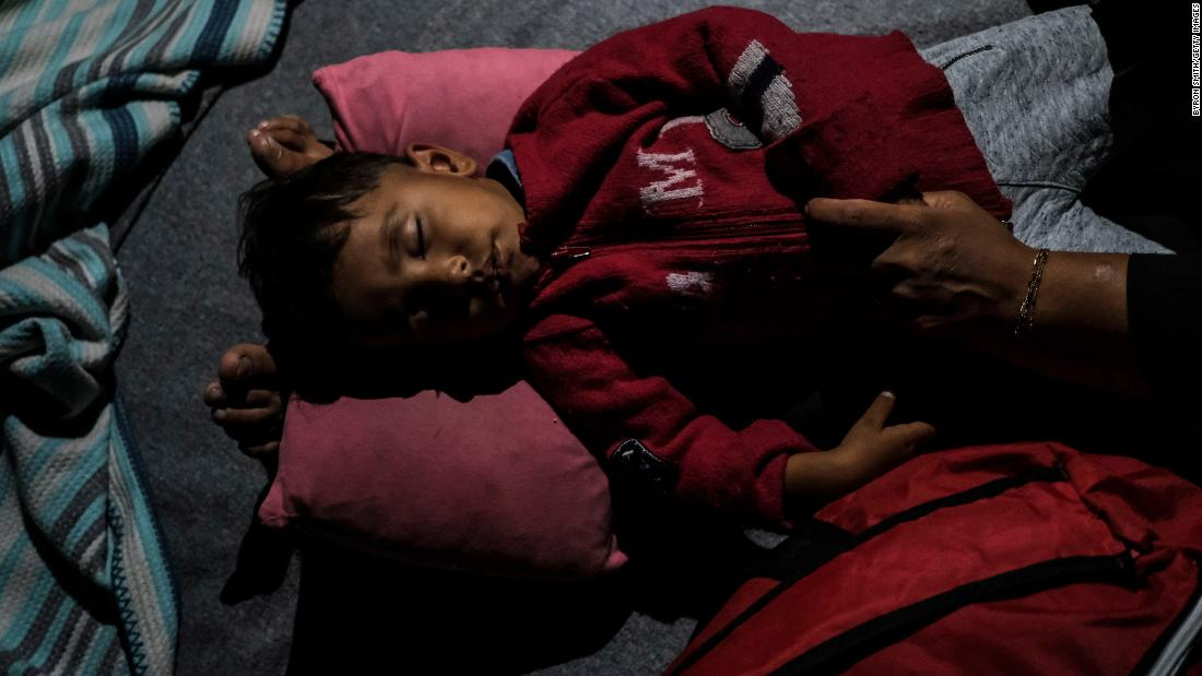 An Afghan child rests after fires broke out in the Moria migrant camp on Tuesday, September 9.