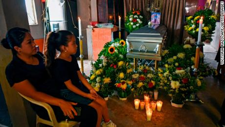 A woman and a girl attend the wake of murdered Mexican journalist Julio Valdivia in Tezonapa.