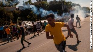 Greek police fire tear gas at protesting migrants on Lesbos