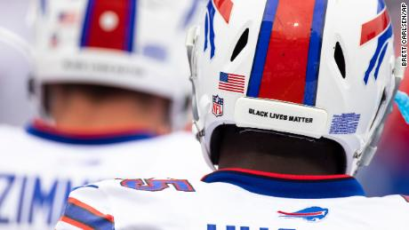 Detail view of a Black Lives Matter sticker on the back of a football helmet worn by Buffalo Bills defensive end Jerry Hughes (55) before the NFL football game against the New York Jets, Sunday, Sept. 13, 2020, in Orchard Park, N.Y.