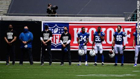"Indianapolis Colts cornerback Isaiah Rodgers, No. 34, and other teammates stand for ""Lift Every Voice and Sing"" before the game between the Jacksonville Jaguars and the Colts."