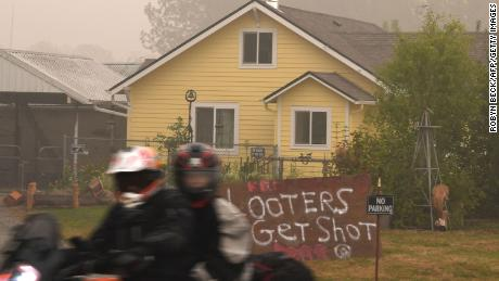"A sign reads ""Looters Get Shot"" outside a residence in Molalla, Oregon, in Clackamas County."