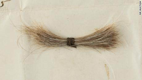 A lock of Abraham Lincoln's hair from 155 years ago has sold at auction.