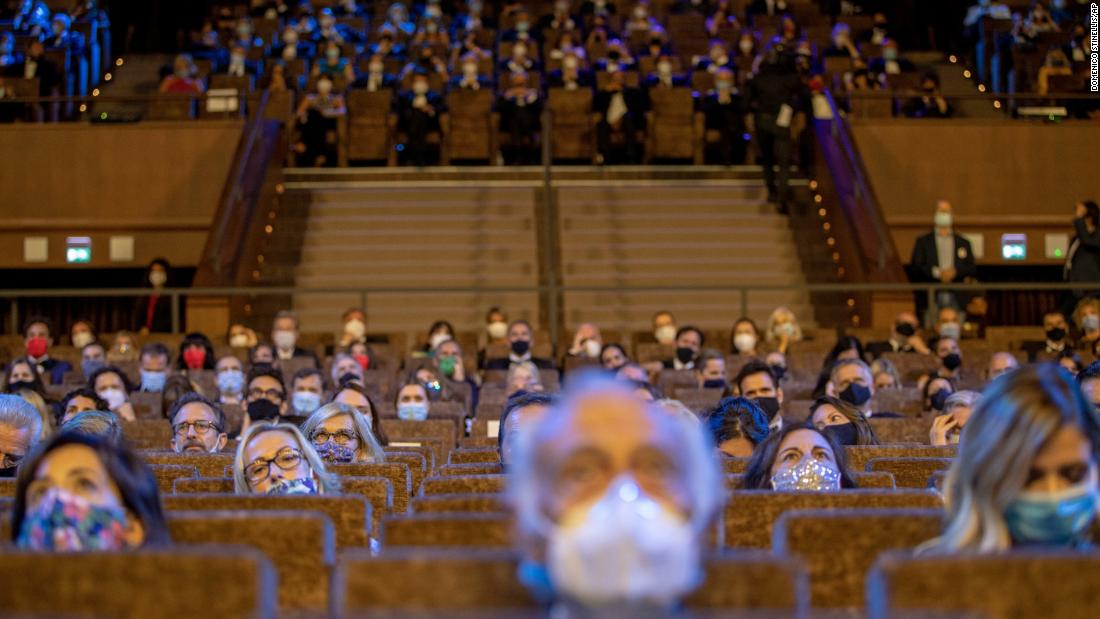 People wear face masks and sit spread apart at the opening ceremony of the Venice Film Festival in Italy on September 2.