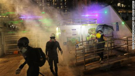 Police fire tear gas to disperse protesters gathered outside a police station in the Tsim Sha Tsui district after taking part in a rally against a controversial extradition bill in Hong Kong on August 10, 2019.