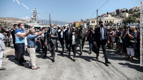 Greece's President Katerina Sakellaropoulou, center, is cheered by residents during her visit to Kastellorizo on Sunday.