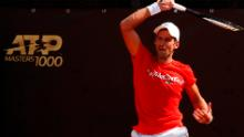 Djokovic returns a forehand during a practice session in Rome, Italy.