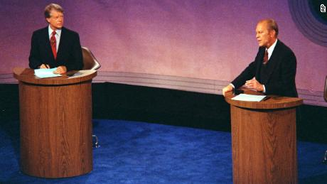 President Gerald Ford speaks as Jimmy Carter listens during the first of three debates at Philadelphia's Walnut Street Theater in 1976.
