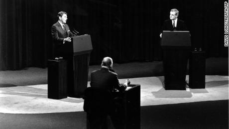 President Ronald Reagan answers a question as Democratic candidate Walter Mondale listens during the second round of the presidential debates in Kansas City, Missouri, in 1984.