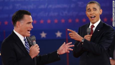 Republican presidential candidate Mitt Romney and President Barack Obama answer questions during a town hall style debate at Hofstra University in Hempstead, New York, in 2012.