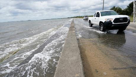 Waters from the Gulf of Mexico pour onto a road Monday in Waveland, Mississippi, as Hurricane Sally closes in.