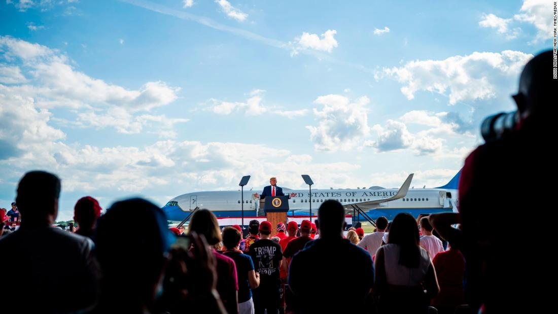 "Trump <a href=""https://www.cnn.com/2020/08/17/politics/donald-trump-campaign-swing/index.html"" target=""_blank"">holds a rally</a> August 17 at Wittman Regional Airport in Oshkosh, Wisconsin."