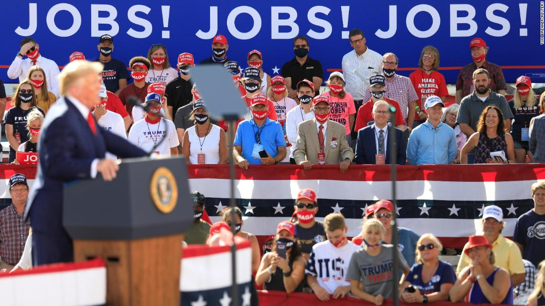 Supporters look on as Trump delivers remarks in Oshkosh on August 17.